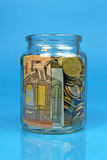 Jar filled with money Stock Photo