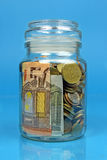 Jar filled with money Royalty Free Stock Photos