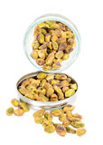 Jar filled with pistachio nuts Royalty Free Stock Images