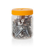 Jar filled with screws and nails Royalty Free Stock Photos