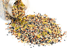 Jar with flax seeds, sunflower seeds, sesame, chia and pumpkin seeds. On a white background Royalty Free Stock Photos