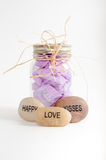 Jar of flower petals with happy, love and kisses rocks Stock Photo