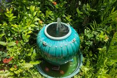 Jar fountain decoration in the green garden.Thailand. Royalty Free Stock Photo