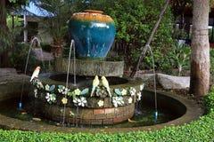 Jar fountain in the garden Stock Image