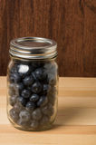 Jar of fresh blueberries on table Royalty Free Stock Photos