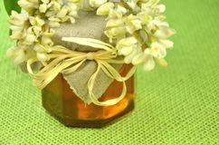 Jar of fresh delicious honey with acacia flowers Royalty Free Stock Images