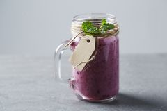 Jar of fresh homemade fruit smoothie,  studio Royalty Free Stock Photos