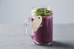 Jar of fresh homemade fruit smoothie,  studio Royalty Free Stock Photos