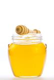 Jar of fresh honey with drizzler isolated on white background Stock Photos