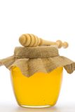 Jar of fresh honey with drizzler isolated on white background Stock Photo