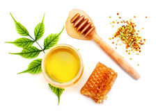 Jar of fresh honey, honeycomb and pollen on a white background. Stock Image