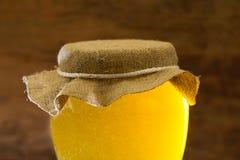 Jar of fresh honey on wooden background Stock Photography