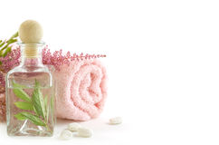 Jar with fresh leaves and towel Stock Photography