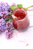 A jar of fresh raspberry jam on light rustic background, close up Stock Image