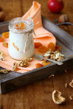 Jar of fresh yogurt with walnuts and apricots Stock Photos