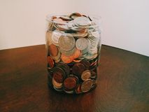 Jar full of change Stock Photos