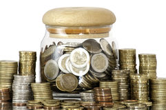 A jar full of coins Royalty Free Stock Images