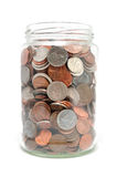 Jar Full of Coins stock images