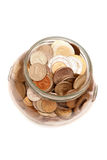 Jar full of coins. Stock Image