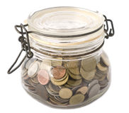 A jar full with coins Royalty Free Stock Photography