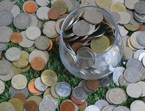 Jar with full of coins Stock Images