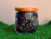 Jar with full of coins whit Stock Images