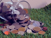 Jar with full of coins whit Royalty Free Stock Photo