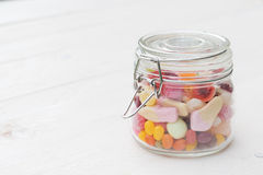 Jar full of colorful candies Royalty Free Stock Image