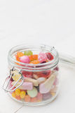 Jar full of colourful candies Royalty Free Stock Photos