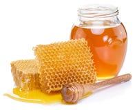 Jar full of fresh honey and honeycombs. Stock Photo
