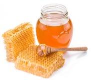 Jar full of fresh honey and honeycombs. Stock Photos