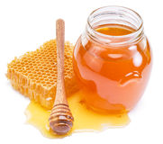 Jar full of fresh honey and honeycombs. Royalty Free Stock Photos