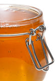 Jar full of honey, isolated Stock Images