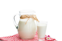 Jar full of milk and glass Royalty Free Stock Photos
