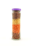 A jar full of multicolored cereals Royalty Free Stock Photography