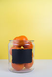 Jar full of oranges with blank chalkboard label. A glass jar full or oranges with a space to write your message on the chalkboard label royalty free stock photo