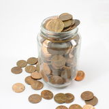 Jar full of Pennies. A jar full of U.S. Pennies isolated on white Royalty Free Stock Image