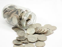 Jar full of quarters. A jar full of U.S. Quarters spilling out Royalty Free Stock Photography