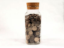 Jar Full of Silver Coins Stock Photography