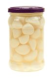 A jar of garlic pieces isolated Stock Photos