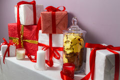 Jar of gingerbread cookies and Christmas gifts Stock Photography
