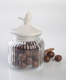 jar or glass jar with chocolate ball on the background. Royalty Free Stock Images