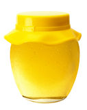 Jar with golden honey isolated on the white background Royalty Free Stock Image