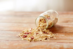 Jar with granola or muesli poured on table Stock Images