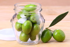 Jar of green olives Royalty Free Stock Image