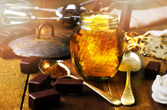 Jar of healthy real honey with honeycomb inside,  chocolate mars Royalty Free Stock Photo