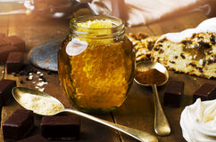 Jar of healthy real honey with honeycomb inside,  chocolate mars Stock Image