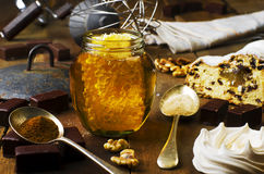 Jar of healthy real honey with honeycomb inside,  chocolate mars Stock Photos