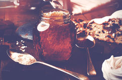 Jar of healthy real honey with honeycomb inside,  chocolate mars Royalty Free Stock Photos
