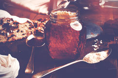 Jar of healthy real honey with honeycomb inside,  chocolate mars Stock Images